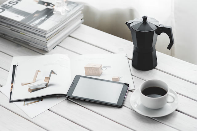 kaboompics.com_Digital tablet with cup of coffee on a white desk
