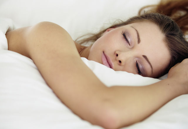cute young woman sleeping on the bed