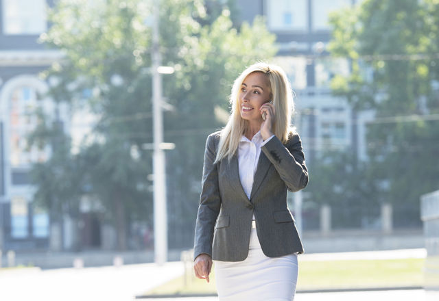 Businesswoman smart phone walking talking