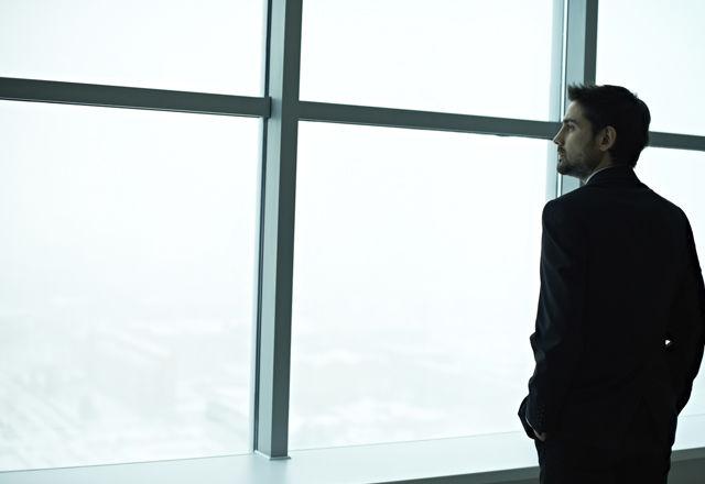 Businessman contemplating
