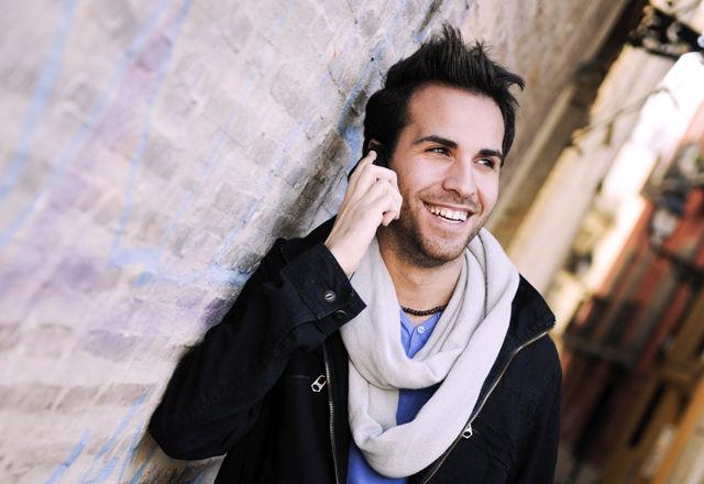 Portrait of handsome man in urban background talking on phone