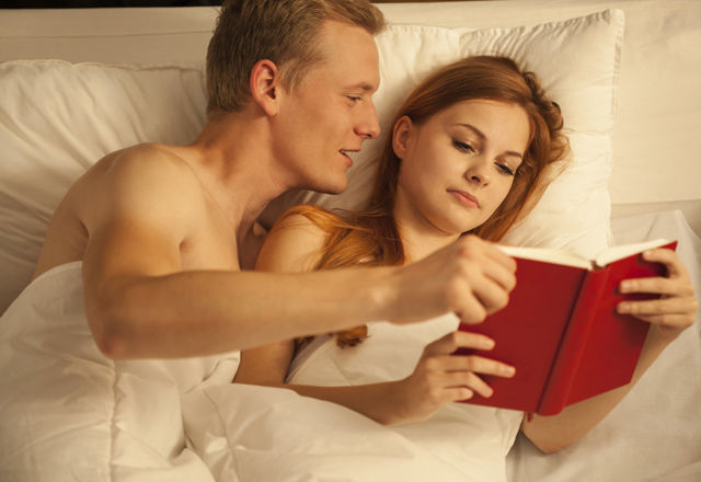 Couple reading red covered book