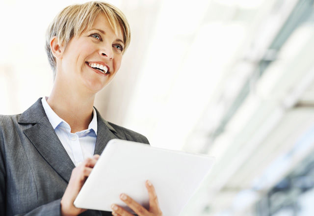 Happy Businesswoman Holding Digital Tablet