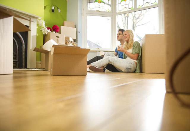 Young Couple Moving into a New Home
