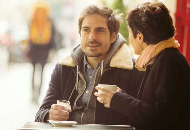 Couple Talking in a Sidewalk Cafe