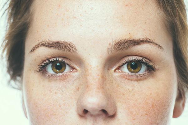 Woman studio beauty portrait freckles with long hair