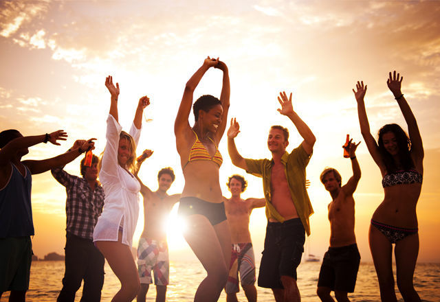 Diverse Young Happy People Dancing at Sunset