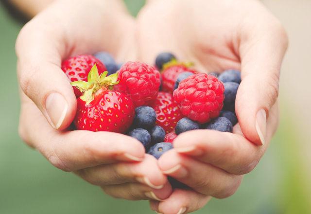 hands holding fresh berries
