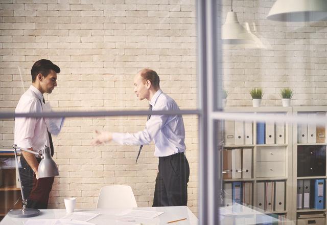 Boss scolding employee
