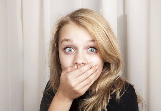 Beautiful blond surprised girl opened her eyes wide