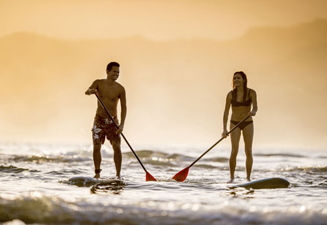 Couple stand up paddleboarding SUP