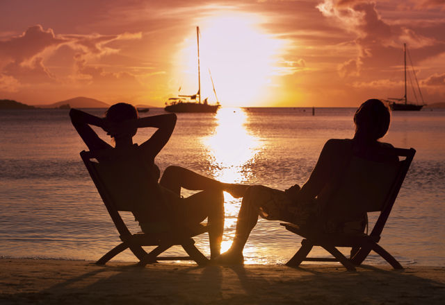 honeymoon couple watching sunset at a Caribbean beach