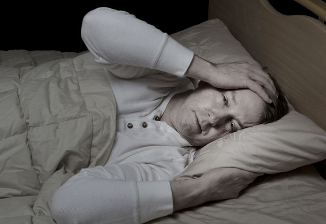Man very sick in bed
