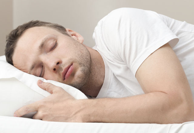 Portrait of sleeping Young Caucasian man in white