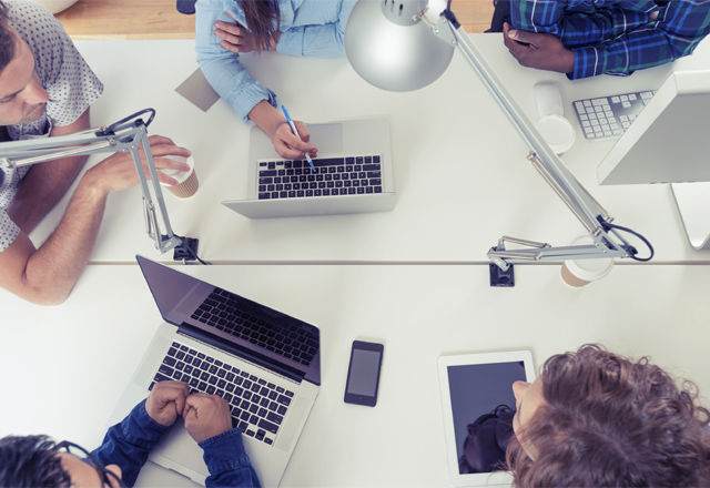 A team of young business people using technology in a meeting