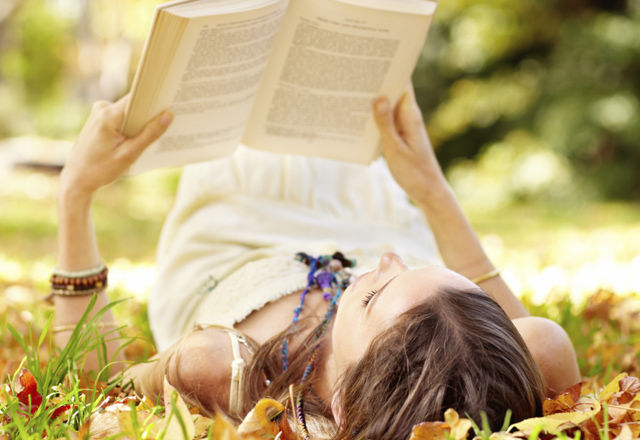 Reading a book in the autumn leaves