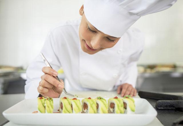Woman making sushi