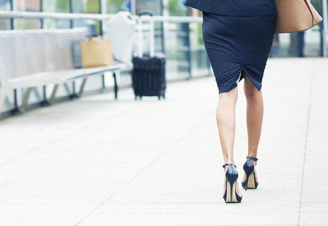 Businesswoman walking away