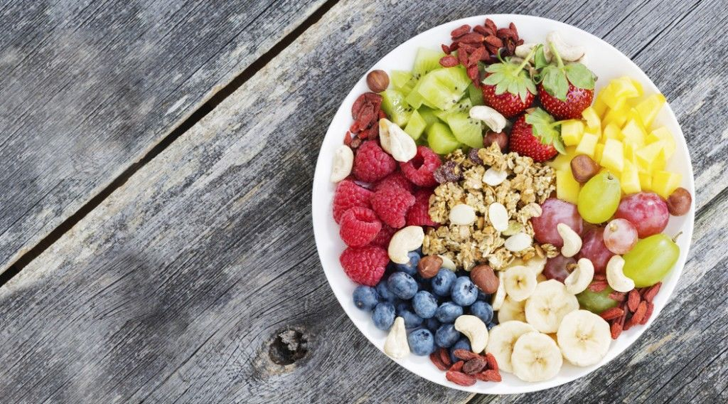 ingredients for a healthy breakfast in one dish on wooden backgr
