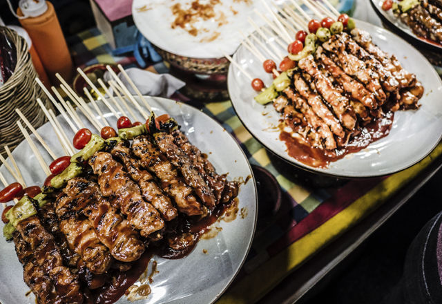 Meat skewers street market stall Bangkok
