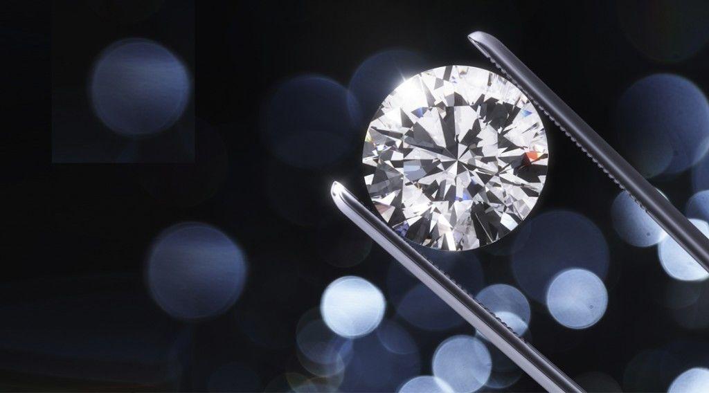 Luxury diamond in tweezers