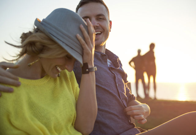 Young couple having a fun time outdoor. It's sunset time in San Diego, California.