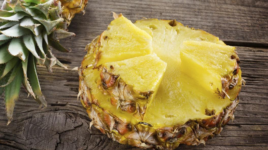 Organic pineapple. Slice and chunk