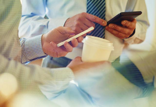 Businessmen with smart phones
