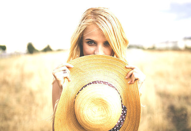 Portrait of young blonde woman in nature