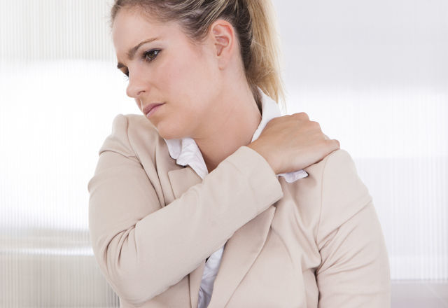 Young Businesswoman Suffering From Shoulder Pain