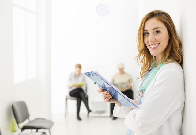 Female Doctor At Hospital Corridor