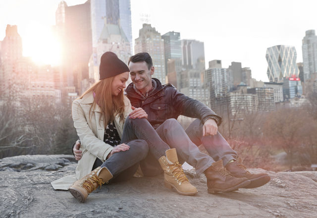 Young Couple sitting together in a City Park